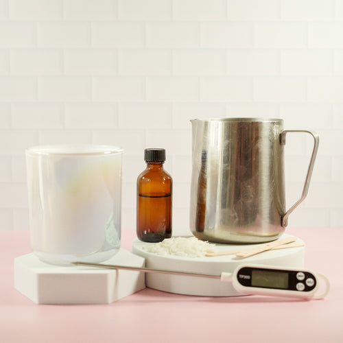 candle making kit including candle vessel, pouring pitcher, thermometer, soy wax flakes and fragrance oil