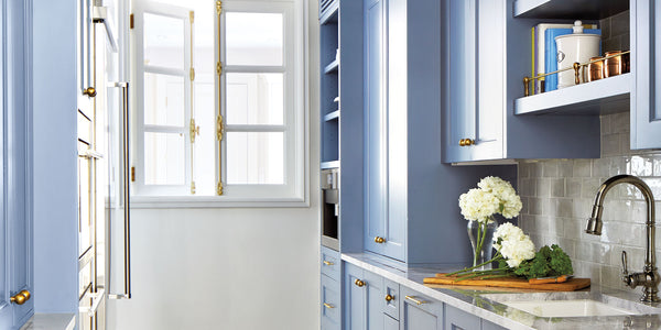 Blue cabinetry/Photographer:Laura Moss/Custom cabinets in Benjamin Moore's Bachelor Blue paint feature prominently in this kitchen by Kim Scodro and Kathryn Scodro of Kim Scodro Interiors.