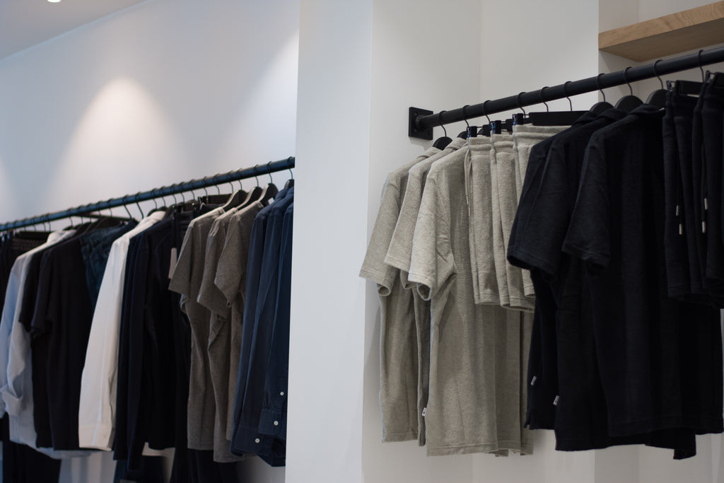 Clothes hanging up inside ACE Men's Clothing Store Mechelen