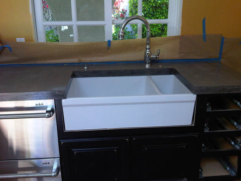 Concrete countertop with apron front sink.
