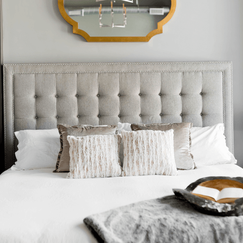 grey and white bed arrangement