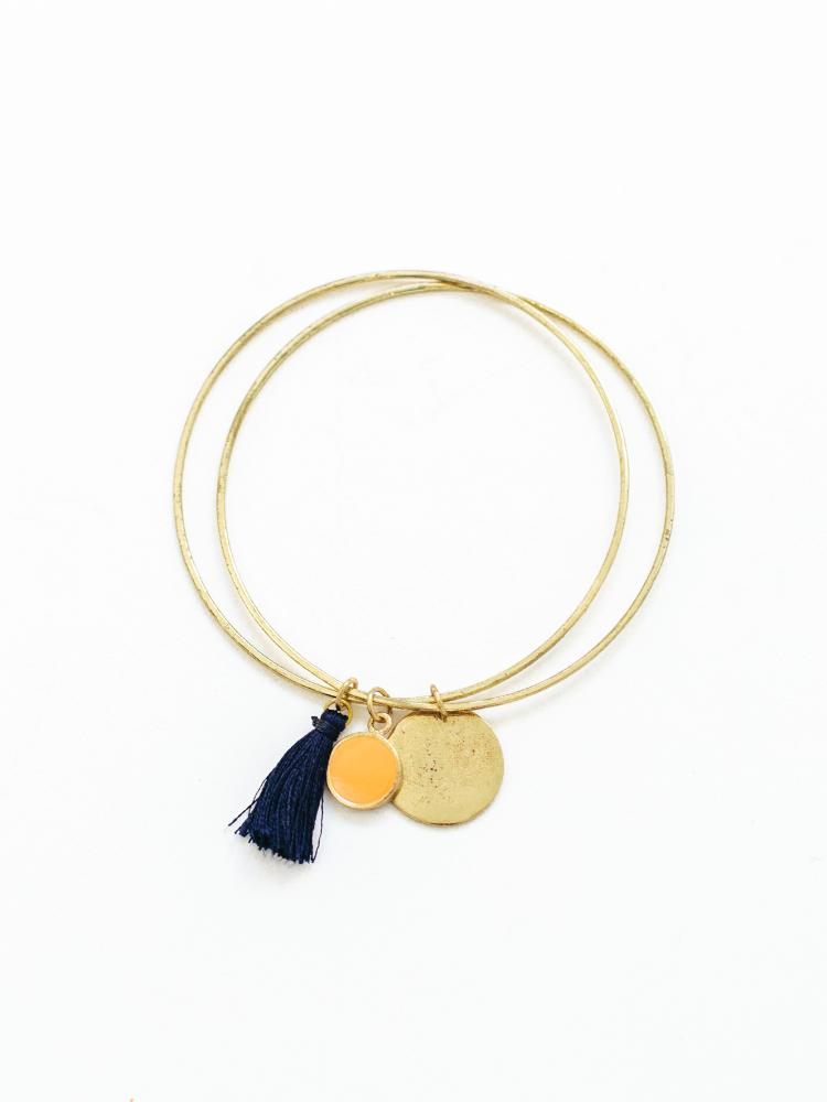 fine double bracelet that has a tassel and 2 circle charms.  Made in a fair trade cooperative in India