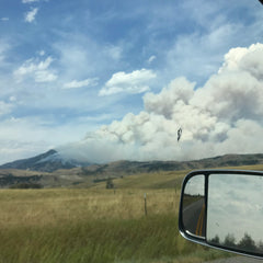 smoke from a forest fire in the Bridger mountains of bozeman montana
