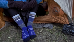 woman sitting in tent wearing alpaca blue urbanite socks