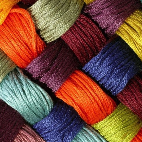 vibrant red, blue, and green alpaca yarn