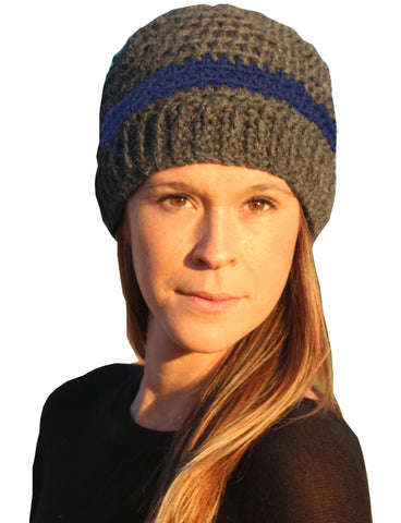woman wearing gray alpaca hat with blue stripe