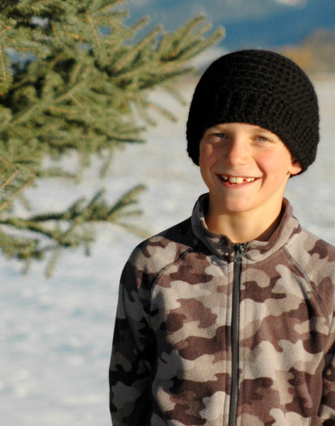 boy wearing black alpaca hat in winter