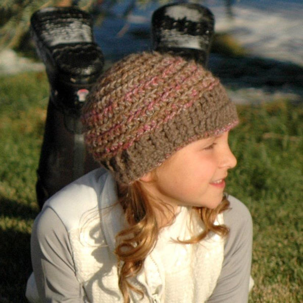 girl wearing a brown and pink alpaca hat