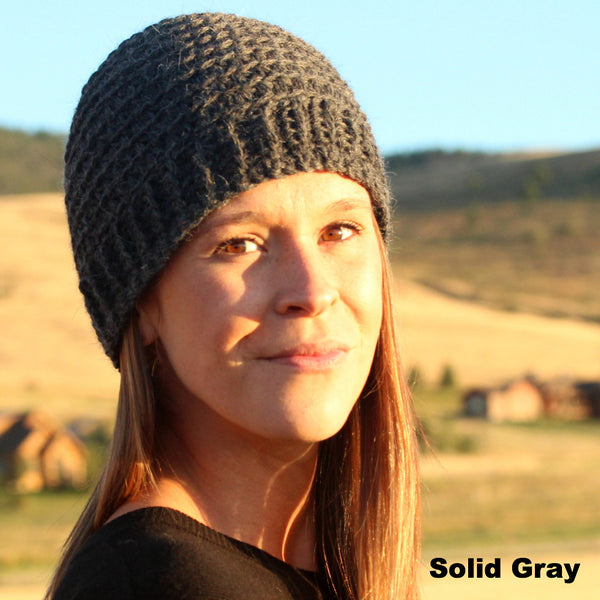 woman wearing gray alpaca hat