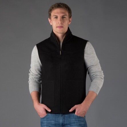 man wearing alpaca wool vest for hunting