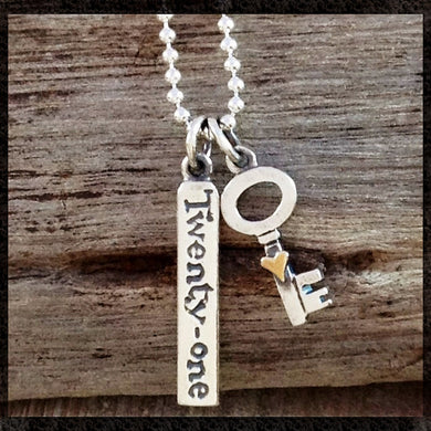 'key to the door, Twenty-one' necklace