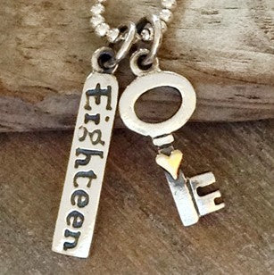 'key to the door, Eighteen' necklace