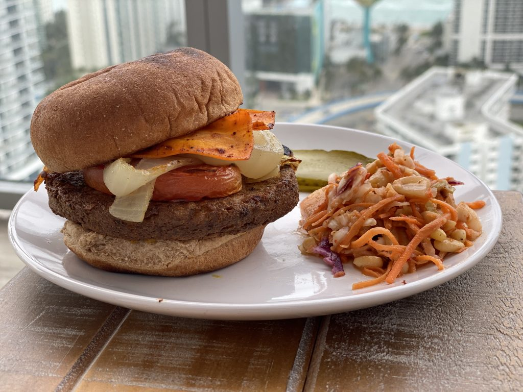 Delicious vegan burger topped with sweet and spicy carrot bacon.