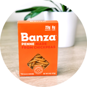 Banza chickpea rotini pasta is a delicious gluten-free pasta that is housed in a striking orange box and can be enjoyed in your favorite plant-based pasta dishes.