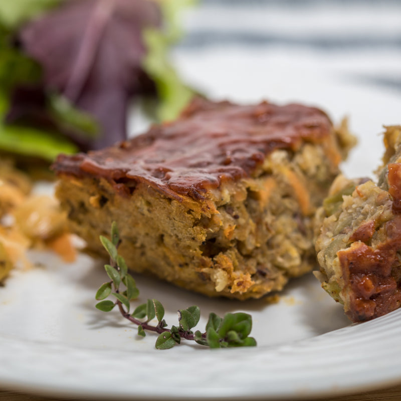 Meatless Meatloaf made from garbanzo beans and black beans plated for the ultimate plant--based Thanksgiving feast.