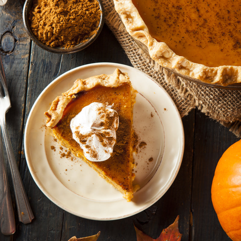 Gluten-free pumpkin pie with plant-based marshmallow fluff topping is plated for the ultimate plant-based Thanksgiving feast.