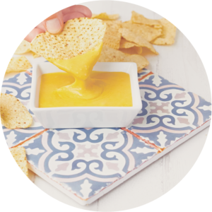 Vegan cheese queso for dipping tortilla chips.