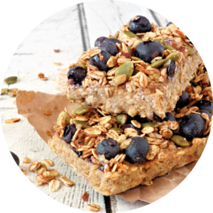 Blueberry breakfast bars can be customized to your liking, with almonds being replaced with pumpkin seeds.