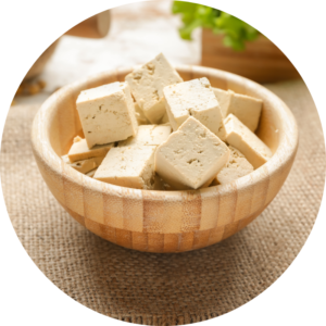 Cubed firm tofu in a wooden bowl.