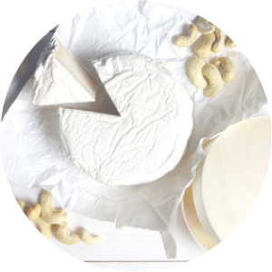 Vegan cheese wheel made from cashew nuts.