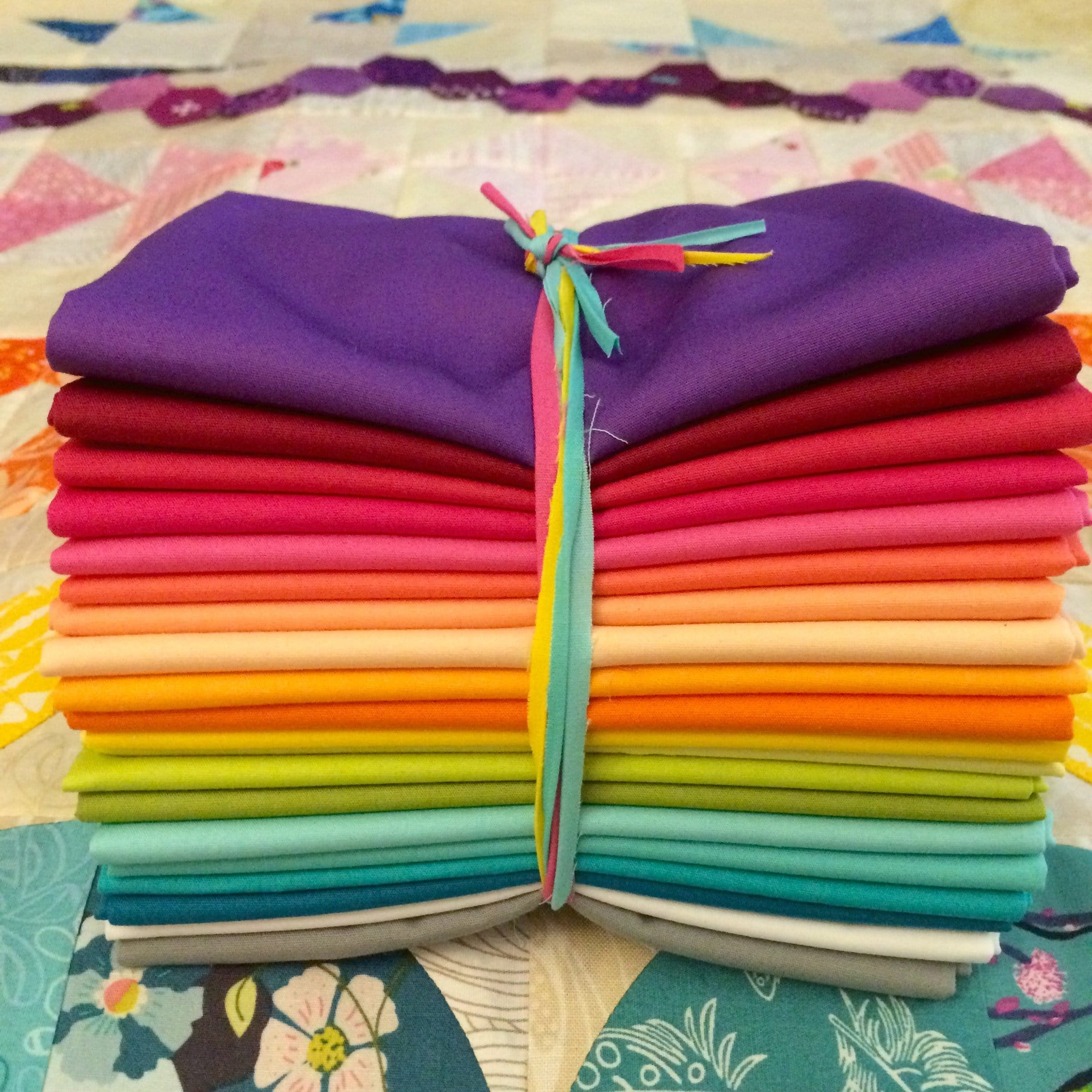 bright blue purple fabric orange red yellow green Bright rainbow fat quarter bundle of hand dyed quilt cotton blue