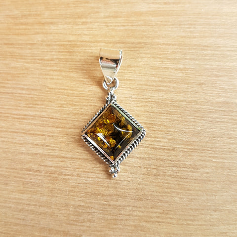 Amber Pendant in a Silver Rope Setting