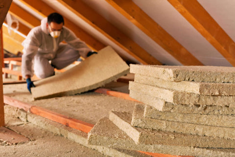 WADE BUILDING SUPPLIES | INSTALLING INSULATION WEARING SAFETY EQUIPMENT