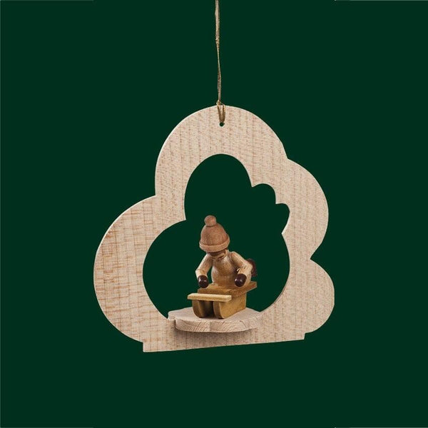 girl on sled tree ornament