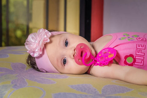 Baby with dummy
