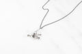 Hand & Flower necklace - silver