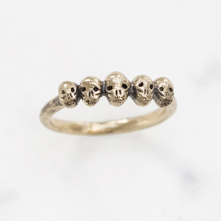 Tiny skulls ring - brass