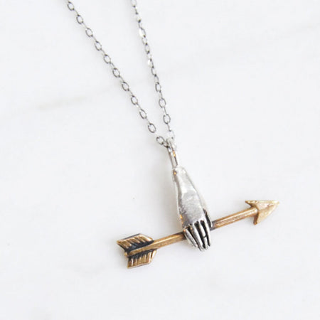 Hand with golden arrow necklace - brass on silver