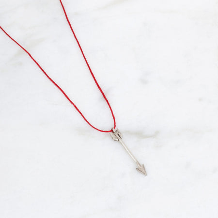 Arrow pendant - silver on red silk