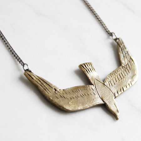 Diving bird necklace - brass
