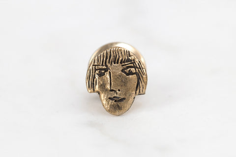 Girl face lapel pin - brass