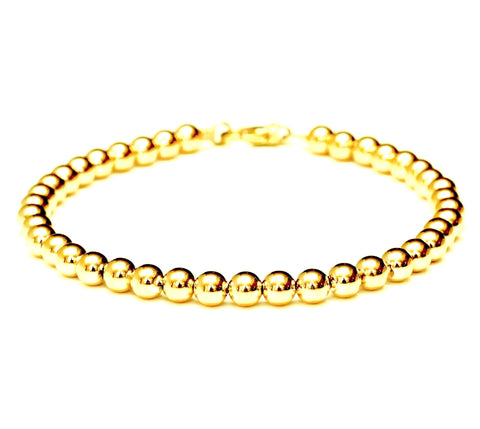 18k gold bead bracelet - 6mm.  Made with medium weight hard-wall beads for extra durability.  Bracelet for women and men.