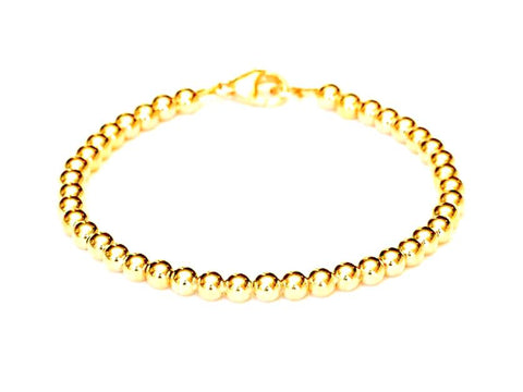 18k gold bead bracelet for men and women, 6mm, 4 grams.  Durable for everyday style to dress up or down.  Stack with other your other bracelets, or wear on its own.