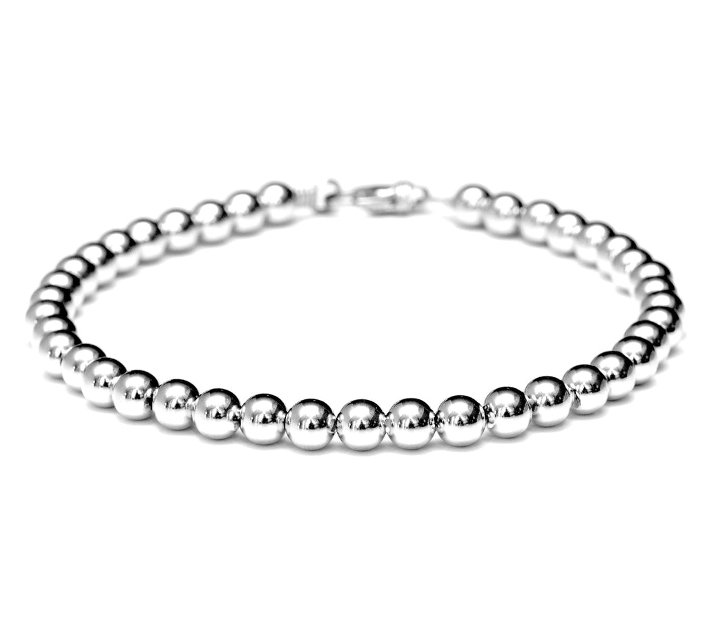 Classic 18k white gold bead bracelet for men and women - 6mm.  Durable for carefree wear.