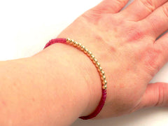 Ruby 14k Gold Bead Bracelet - model view