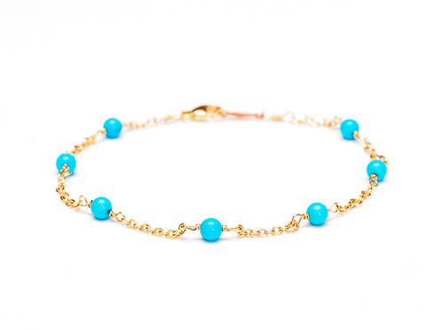 14k gold chain station bracelet with turquoise gemstones.   Great as a stacking bracelet or on its own.