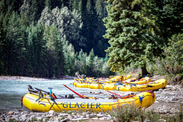 Glacier Raft Company boats sitting by Kicking Horse River in Golden, BC