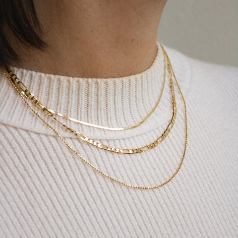 Three solid gold chain layers by Leah Alexandra Jewelry and Violette Studio