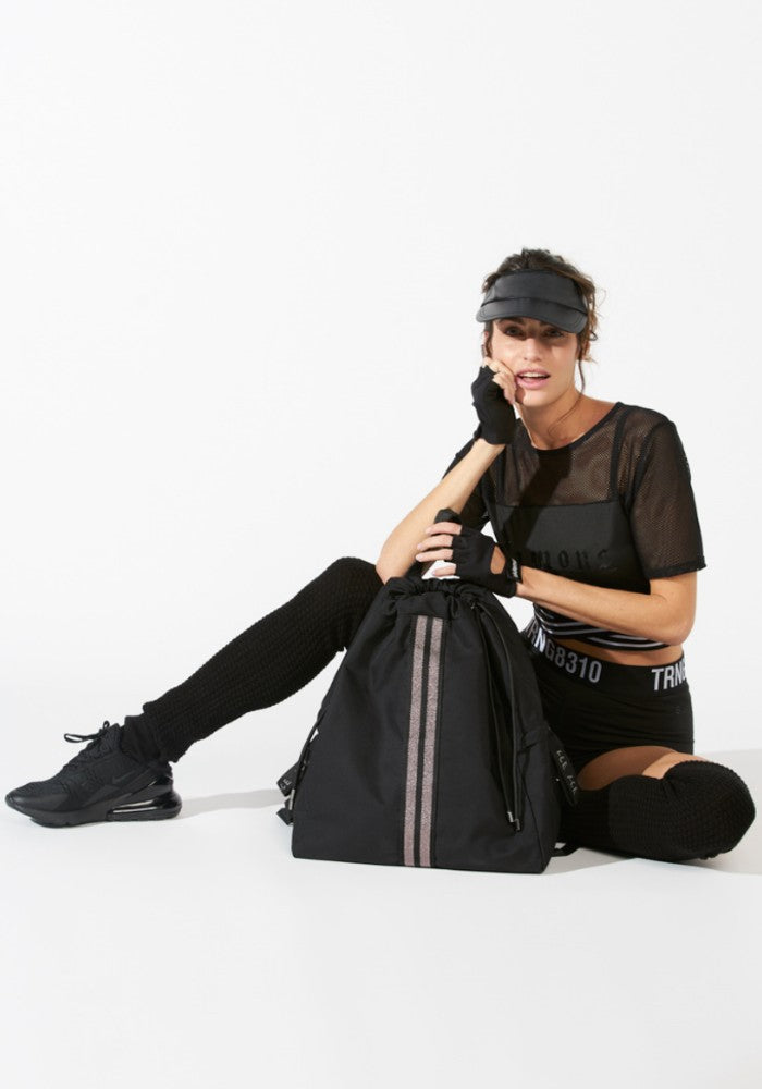 Woman carrying a ACE Bagpack color Black made with ECONYLu00ae regenerated nylon