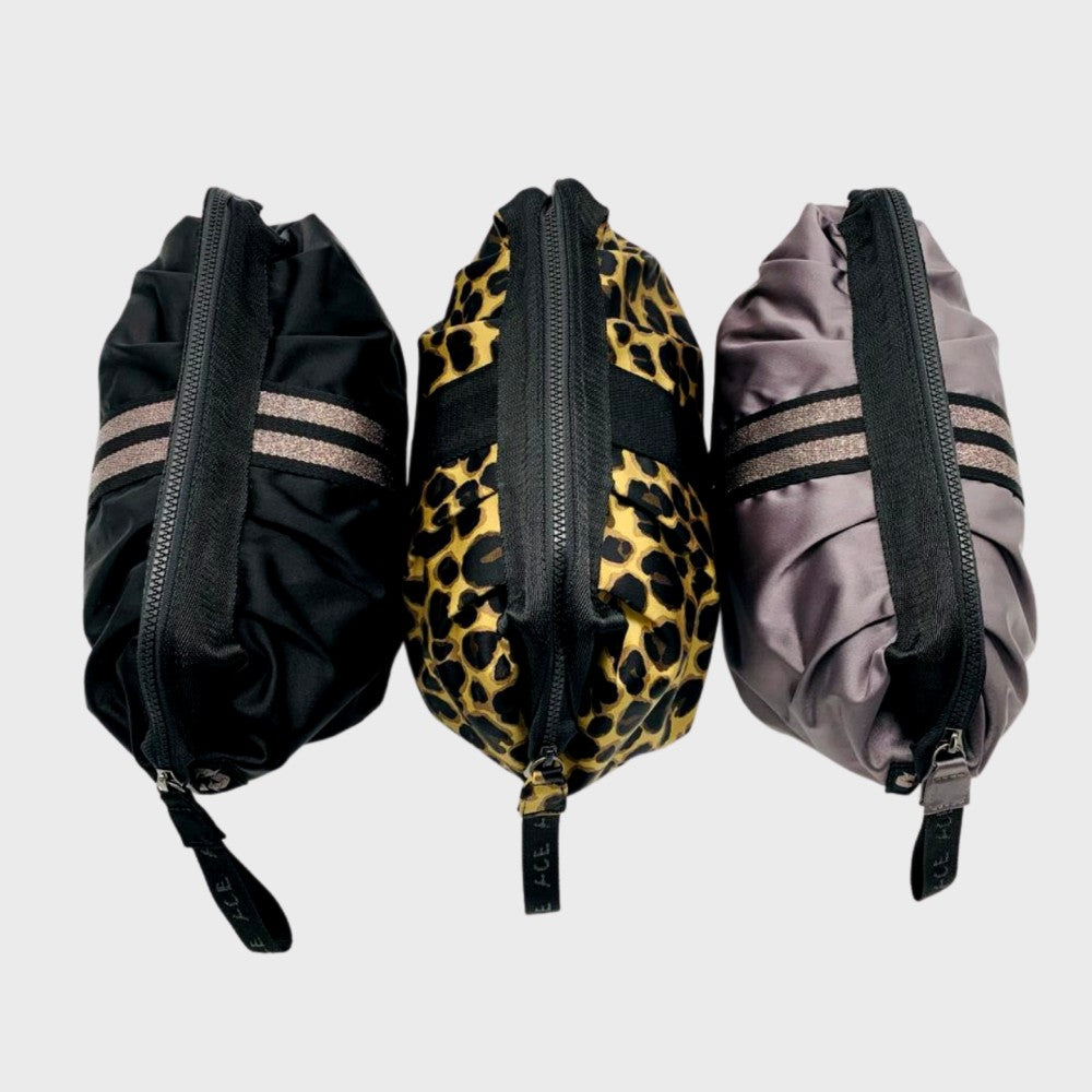Three ACE Cosmetic Bag color Black Mauve Leopard made with ECONYLu00ae regenerated nylon