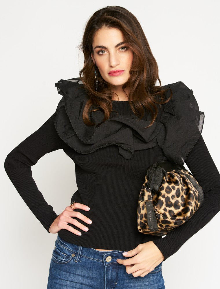 Woman carrying a ACE Cosmetic Bag color Leopard made with ECONYLu00ae regenerated nylon