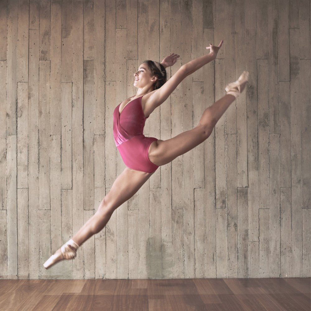 Dancer wearing the Coppelia leotard in pink Aisy Dance made with ECONYLu00ae regenerated nylon