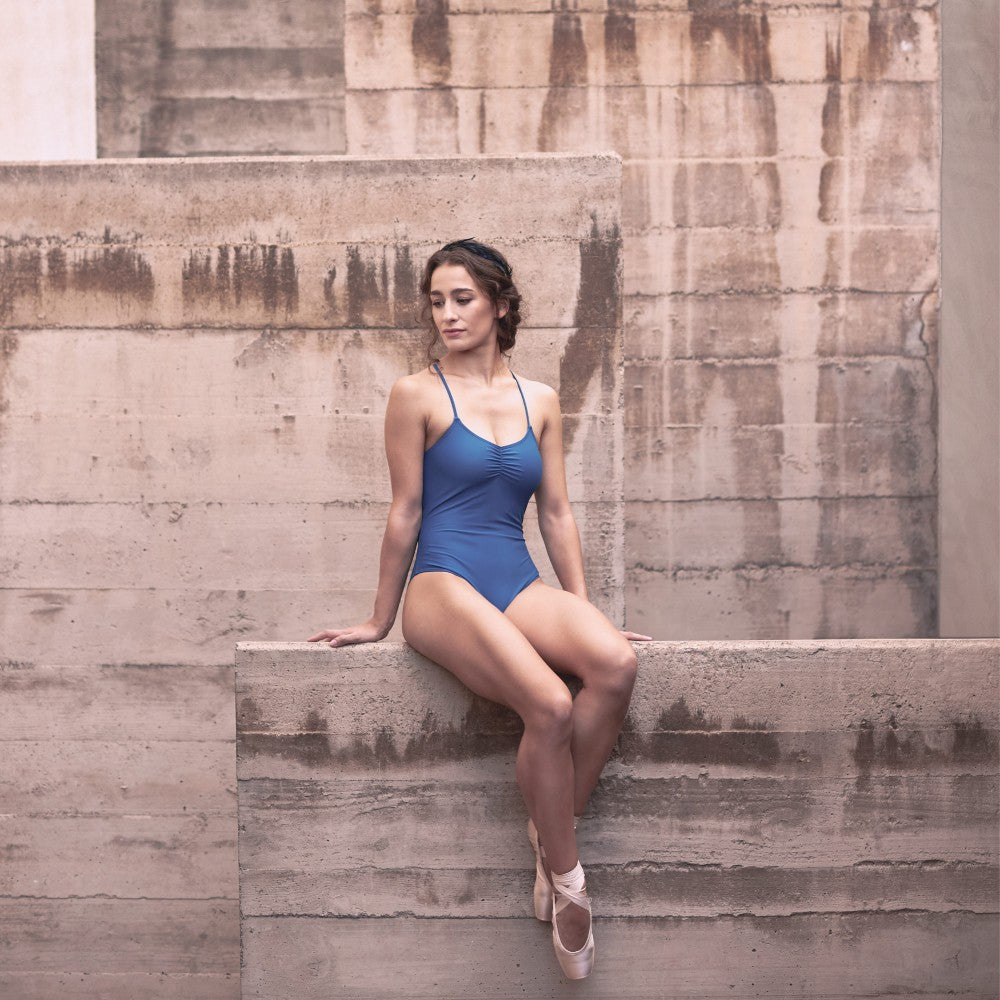 Dancer wearing the Effie leotard in blue Aisy Dance made with ECONYLu00ae regenerated nylon