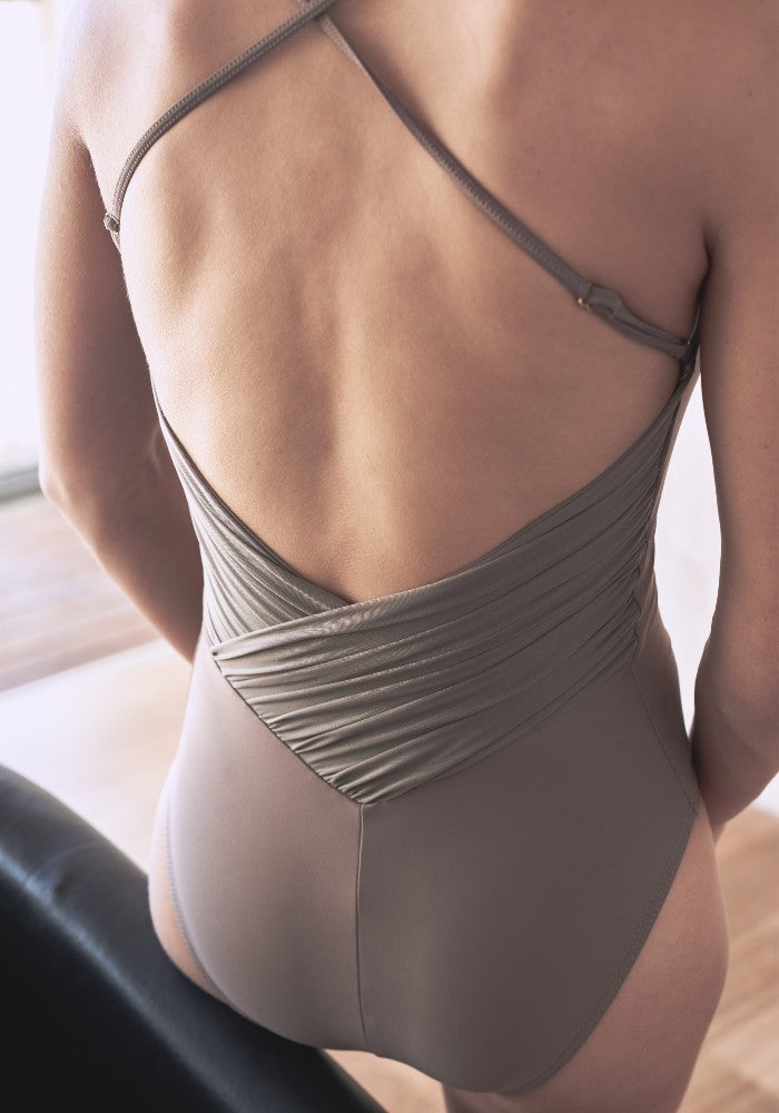Detail of the Effie leotard in brown Aisy Dance made with ECONYLu00ae regenerated nylon