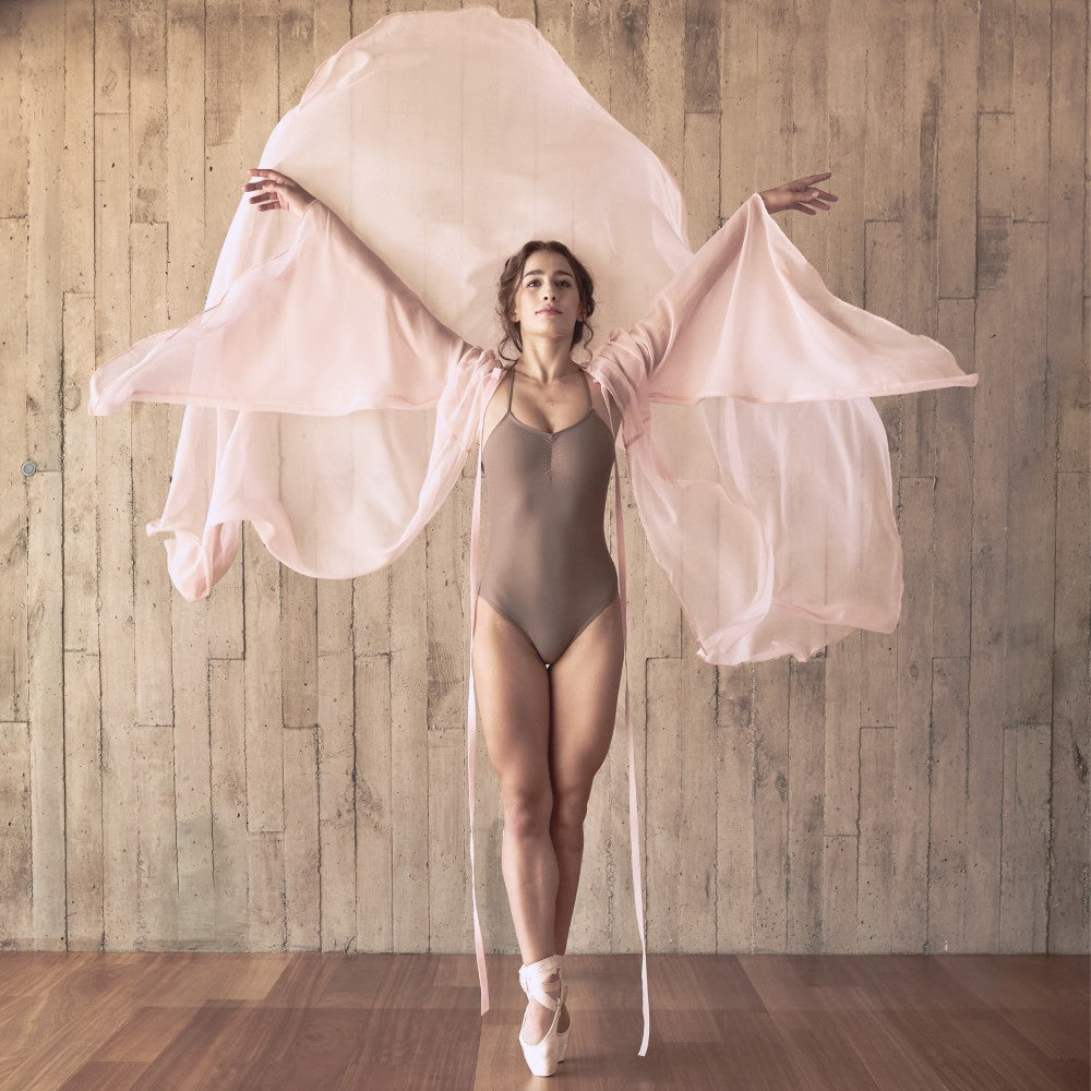 Dancer wearing the Effie leotard in brown Aisy Dance made with ECONYLu00ae regenerated nylon