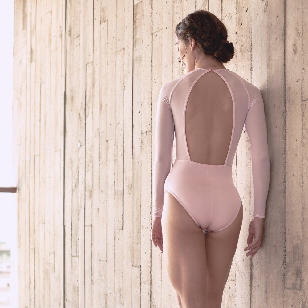 Back view of a dancer wearing the Helena leotard in pink Aisy Dance made with ECONYLu00ae regenerated nylon